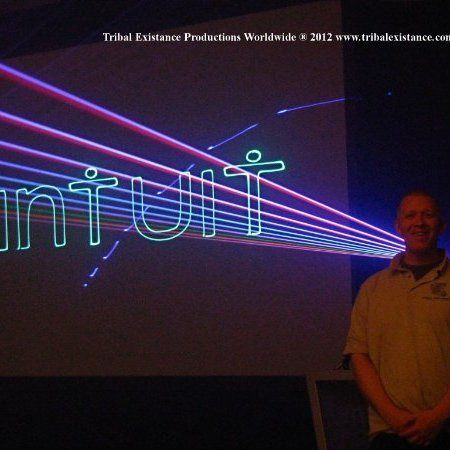 Intuit Laser Logo Event Display Graphic Laser Stage Design Rentals by Tribal Existance Productions Worldwide